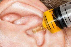 causas de ouvido vermelho e quente