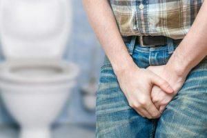 o que causa o desejo de urinar, mas nada sai'
